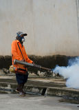 Dengue control. WARINCHAMRAB, UBON RATCHATHANI, THAILAND - JULY 24 : The unidentified officer is spraying chemical for dengue control on July 24 , 2013 in stock photography