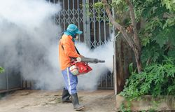 Dengue control. WARINCHAMRAB, UBON RATCHATHANI, THAILAND - JULY 24 : The unidentified officer is spraying chemical for dengue control on July 24 , 2013 in royalty free stock photos