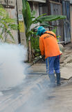 Dengue control. WARINCHAMRAB, UBON RATCHATHANI, THAILAND - JULY 24 : The unidentified officer is spraying chemical for dengue control on July 24 , 2013 in royalty free stock images