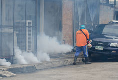 Dengue control. WARINCHAMRAB, UBON RATCHATHANI, THAILAND - JULY 24 : The unidentified officer is spraying chemical for dengue control on July 24 , 2013 in royalty free stock image
