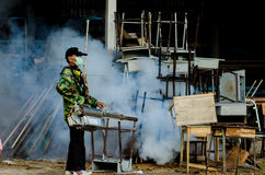 Dengue fever. UBONRATCHATHANI, THAILAND - SEPTEMBER 9 ; The unidentified officer is spraying chemical for an outbreak of dengue fever on September 9, 2013 in stock image