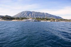 Denia city view from Mediterranean sea Royalty Free Stock Images