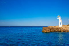 Denia Las Rotas Trampoli beach and tower Spain Royalty Free Stock Photography