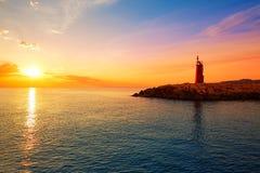 Denia solnedgångfyr på skymning i Alicante Royaltyfria Foton