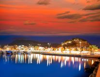Denia sunset with castle and marina royalty free stock image
