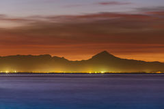 Denia sunset view from port. Sunset view with mountains on background. Denia, Spain Royalty Free Stock Image