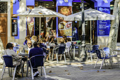 Denia, Valencia, Spain. The center of Denia, on a sunny day, with Spaniards on the terraces Stock Image