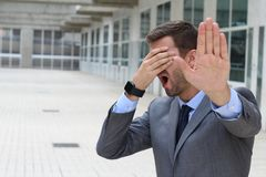 Denial concept with businessman covering his eyes royalty free stock photography