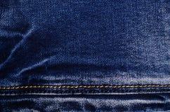 denim голубые джинсы предпосылки славные стоковое фото