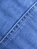 Denim. Material with seam running diagonally royalty free stock images