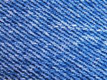 Denim. Blue jeans old denim cloth close up Stock Image