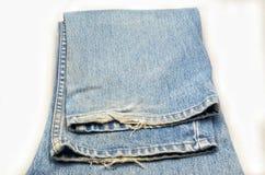 Denim auf Weiß Jeans auf Isolat Stockfotografie