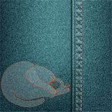 Denim background with embroidered cat. Royalty Free Stock Image