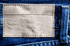Denim background with label Stock Photography