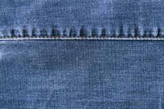 Denim background with seam on top. stock photography
