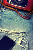 Denim background with smartphone,  camera Royalty Free Stock Image
