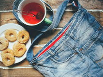 denim bag, a cup of tea and homemade cookies on wooden boards Royalty Free Stock Photos