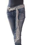 Denim belt. Denim belt is on womens hip royalty free stock photos