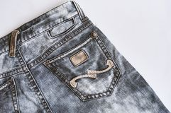 Denim black vintage jeans texture with pocket close up. stock photo