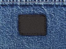 Denim With a Blank Tag. Photograph of a blue denim jeans pocket with a blank black tag sewed on it Royalty Free Stock Images