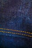 Denim bleu et jaune avec piquer photo stock