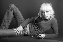 Denim-blondes Mädchen Stockfoto