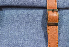 Denim blue with a brown strap . Royalty Free Stock Image