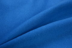 Denim blue cloth made by cotton fiber Royalty Free Stock Photography