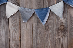 Denim blue flags garland with space for text Royalty Free Stock Photo