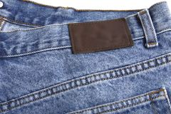 Denim blue jeans rear with label Stock Photography