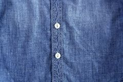 Denim blue jeans shirt with buttons texture Royalty Free Stock Photography