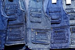Denim blue jeans vest rows in a retail shop Royalty Free Stock Photos