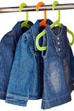 Denim child clothes  hang  in a closet Stock Images