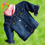 Denim child  jacket withkerchief Stock Photos