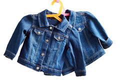 Denim child  jackets on a white  background Royalty Free Stock Photo