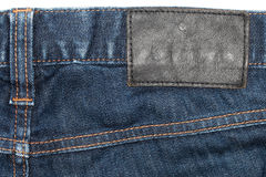 Denim Closeup : texture background of leather label on blue jean Stock Photos