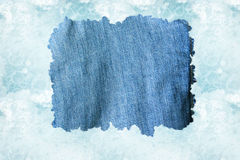 A denim cloth against a light blue water backgroun. A blue jeans fabric, against a watered background (sea, storm sky, as you please vector illustration