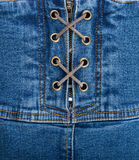 Denim corset. A fragment of blue denim corset Royalty Free Stock Image
