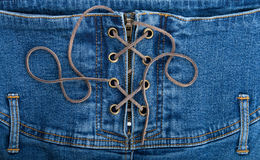 Denim corset. A fragment of blue denim corset Royalty Free Stock Photos