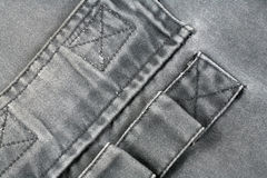 Denim. Detail view on a gray denim Royalty Free Stock Photography