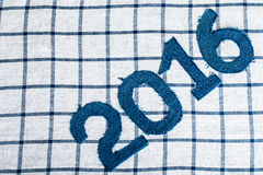 Denim digits 2016 on a checkered cloth background. Toned Stock Photos