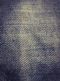 Denim fabric background. Worn blue denim weave Royalty Free Stock Images