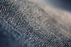 Denim fabric, jeans macro, thick cotton fabric Royalty Free Stock Image