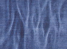 Denim fabric texture with ripples Stock Photo