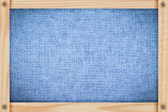 Denim fabric in a wooden frame Stock Images