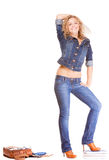 Denim fashion. Full length student girl in blue jeans bag books Stock Image