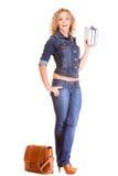 Denim fashion. Full length student girl in blue jeans bag books Stock Image