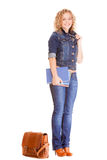 Denim fashion. Full length student girl in blue jeans bag books Royalty Free Stock Image