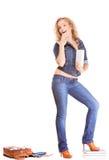 Denim fashion. Full length student girl in blue jeans bag books stock photography