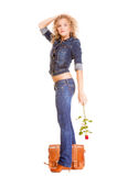Denim fashion. Full length student girl in blue jeans bag holds red rose Stock Images